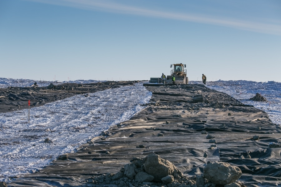 Laying out geotextile on Inuvik-Tuktoyaktuk Highway