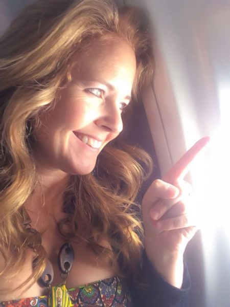 Tawna looking out plane window